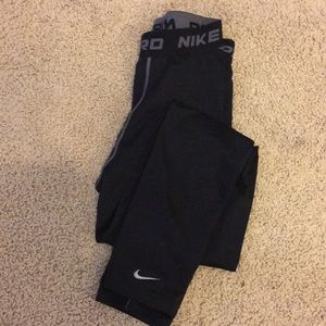 2 pairs of performance legging, youth L & M